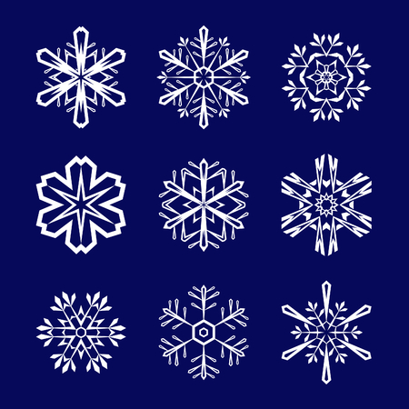 Set of white snowflakes on blue background Stock Vector - 8572928