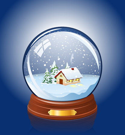 Snowy glass ball with a home within