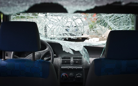car glass: Interior of car with smashed, shattered windshield