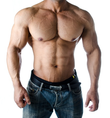 Muscular torso, pecs, abs and arms of male bodybuilder in jeans - isolated on white background photo