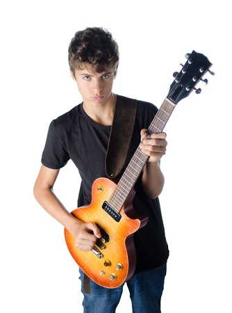 teenager boy standing and playing guitar serious isolated on white photo