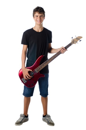 teenager boy with bass guitar smiling isolated on white Standard-Bild