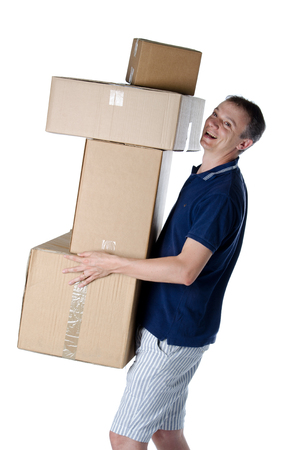 Handsome man carrying cardboard boxes isolated on white photo