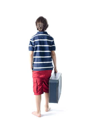 Lonely child with suitcase going away isolated on white photo