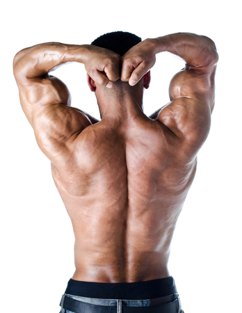Bodybuilder with arms over his head showing muscular shoulders, arms and back - isolated on white photo