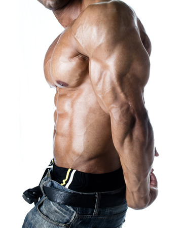 side profile: Detail of male bodybuilder torso: ripped abs, thick pecs and huge tricep and arm on white background Stock Photo