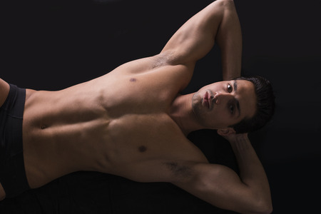 latin man: Handsome latin young man on floor, wearing only underwear. Muscular build