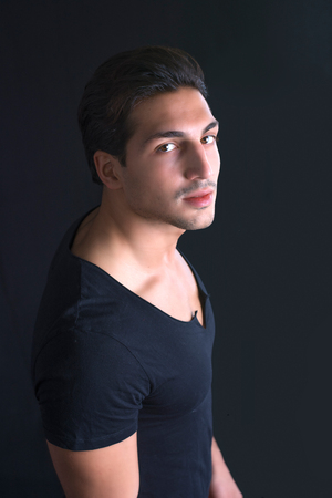 brown  eyed: Brown eyed, black haired latin man on dark background photographed from above Stock Photo