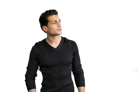 haired: Brown eyed, black haired latin man standing on white background looking to a side Stock Photo