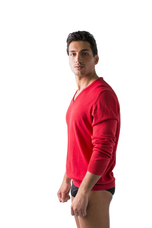man underwear: Young man with red wool sweater and underwear, profile view. Isolated on white Stock Photo