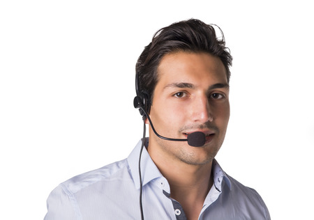 telemarketer: Young male telemarketer or support center receptionist with headset, isolated on white Stock Photo
