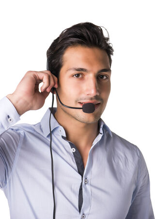 telemarketer: Young male telemarketer or call center operator with headset, smiling, isolated on white