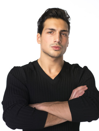 brown  eyed: Brown eyed, black haired latin man standing on white background with arms crossed on chest
