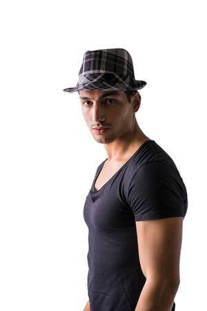 grey eyed: Young man with dark t-shirt and black and white checkered hat isolated on white background, looking at camera Stock Photo
