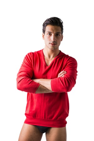 A young man with red wool sweater and underwear, front view, arms crossed on chest. Isolated on white background