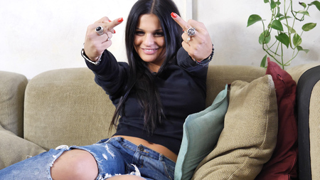 Pretty young woman showing middle fingers gesturing Screw You