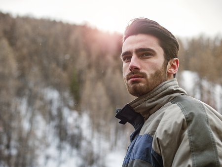 Young handsome man in winter sportswear looking away Imagens