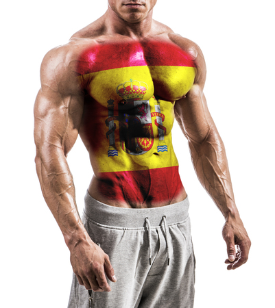 Torso of shirtless muscular man with Spain flag painted on naked chest, isolated on white in studio shot