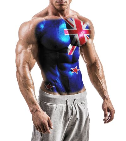 Torso of shirtless muscular man with New Zealand flag painted on naked chest, isolated on white in studio shot Standard-Bild