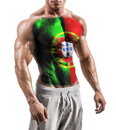 Torso of shirtless muscular man with Portugal flag painted on naked chest, isolated on white in studio shot
