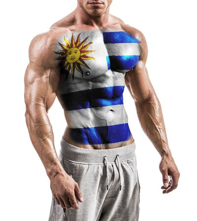 Torso of shirtless muscular man with Uruguay flag painted on naked chest, isolated on white in studio shot