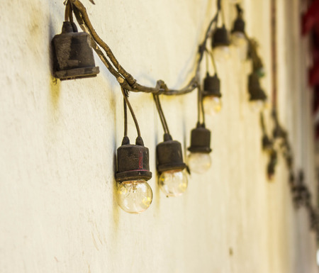 Old lamp hanging on the wall. photo