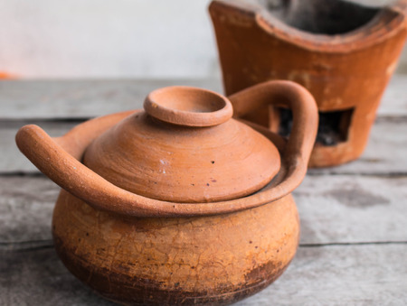 Villagers use clay pot cooking. photo