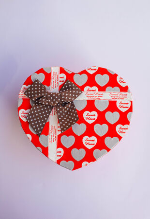 Red heart shaped gift box on a white background. photo