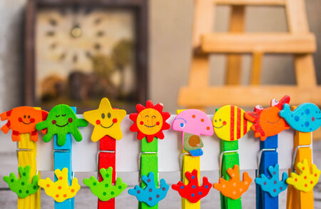 Colorful peg in a row. photo