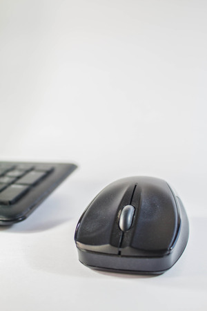Mouse and keyboard on the floor photo