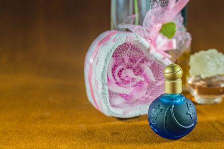 perfumery concept: Blue perfume bottle in wedding