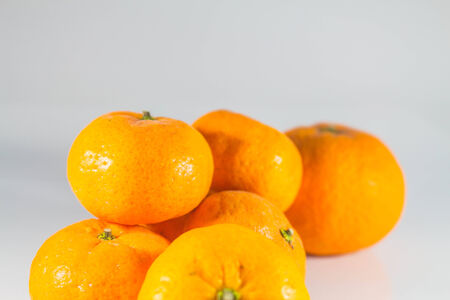 put together: Tangerine put together on a white background.