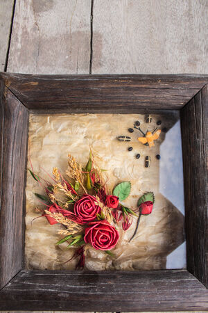 Floral decorations on the wooden photo