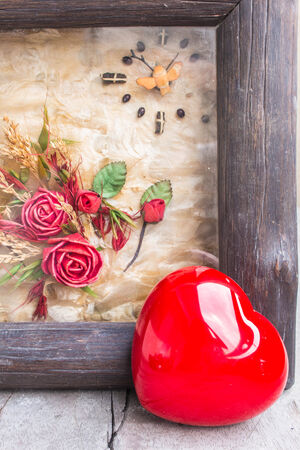 Heart and frame on a wooden photo