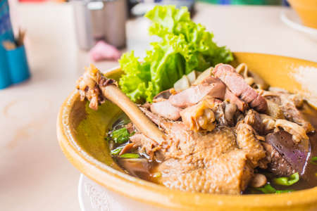 cooked instant noodle: Noodles made from duck meat on the table.