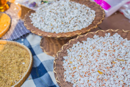 popped: popped rice in wooden containers of the community Stock Photo