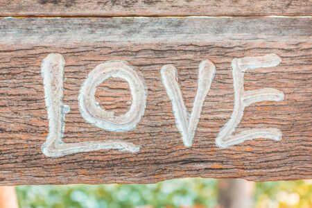 carved letters: Symbol of love letters carved on wood. Stock Photo