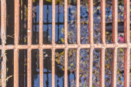 hard alloy: Steel grating cover off the old rusty pipes. Stock Photo