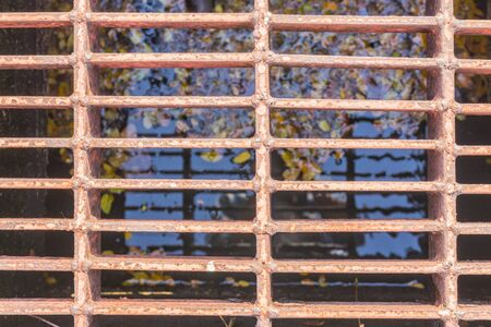 hard alloy: Steel grating cover off the old pipe. Stock Photo