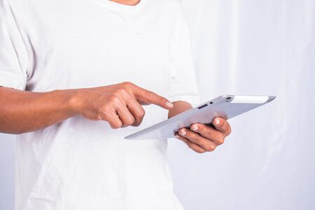 Men who are using tablets. photo