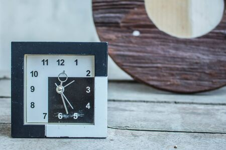past midnight: Watch contemporary on a wooden