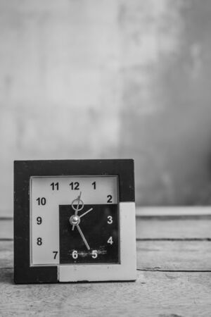 past midnight: Old clock on a black and white background.