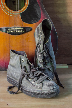 old shoes: Vintage old shoes on a wooden floor.