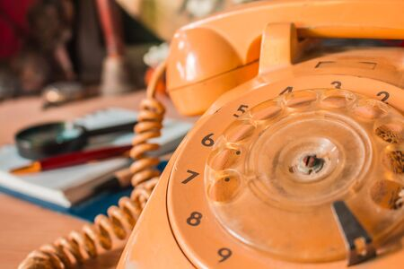 oldstyle: Old-style rotary phone numbers on table