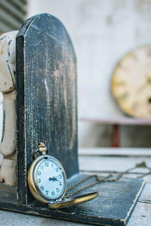 past midnight: Classic antique clock on wood. Stock Photo