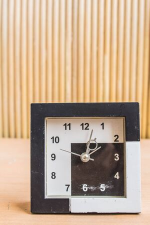 past midnight: Watch vintage on wooden background.