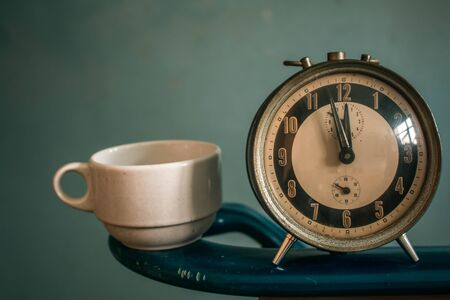 ten empty: clock and coffee cup on the background. Stock Photo