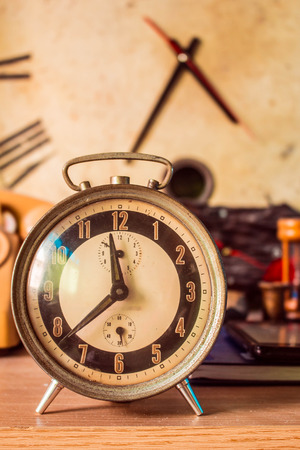 8 years old: Old clock on a wooden table Stock Photo