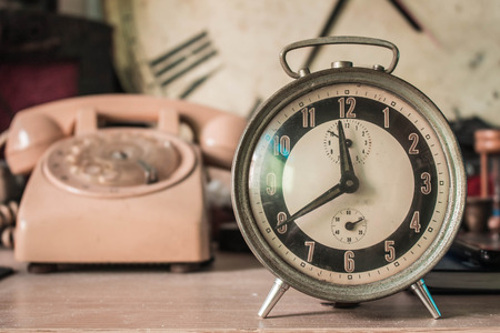 back in an hour: Vintage photo of the old clock. Stock Photo