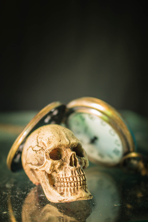 old timer: Skull and old timer in the dark. Stock Photo